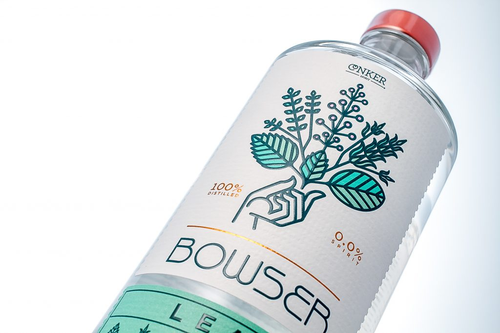 A bottle of Bowser Leaf from Conker distillery. The bottle label is white, with a pale green leaf logo.