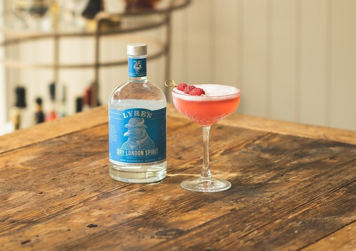 A bottle of Lyre's Dry London Spirit Non Alcoholic Gin with a Clover Club Cocktail