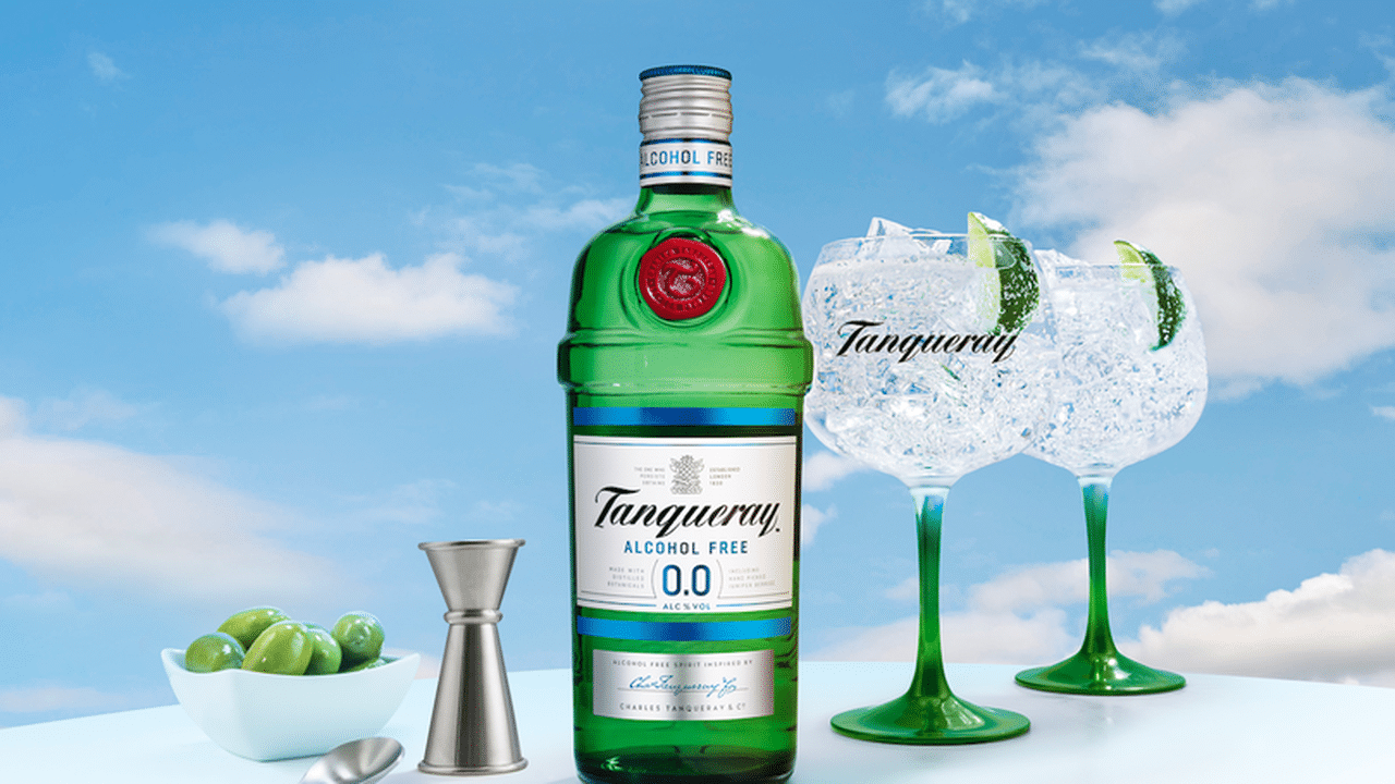 A 70cl bottle of Tanqueray 0.0 non alcoholic gin with two copa glasses and a jigger.