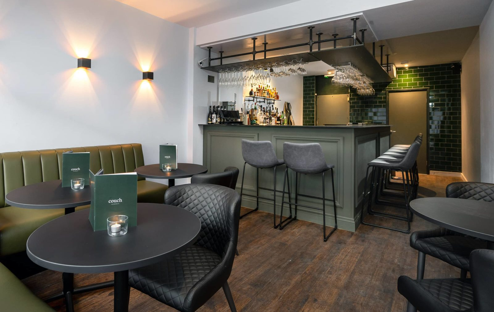 The green themed interior bar at Couch, Stirchley