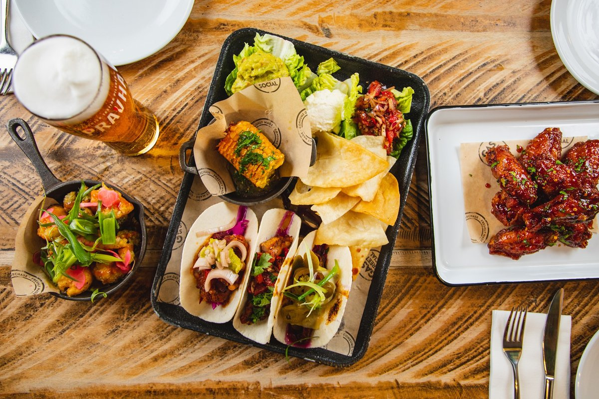A tray of tacos, a plate of wings and a pint of Pravha lager at Gas Street Social Birmingham