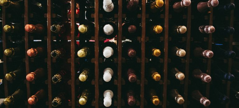 A wine shelf with bottles neatly stacked