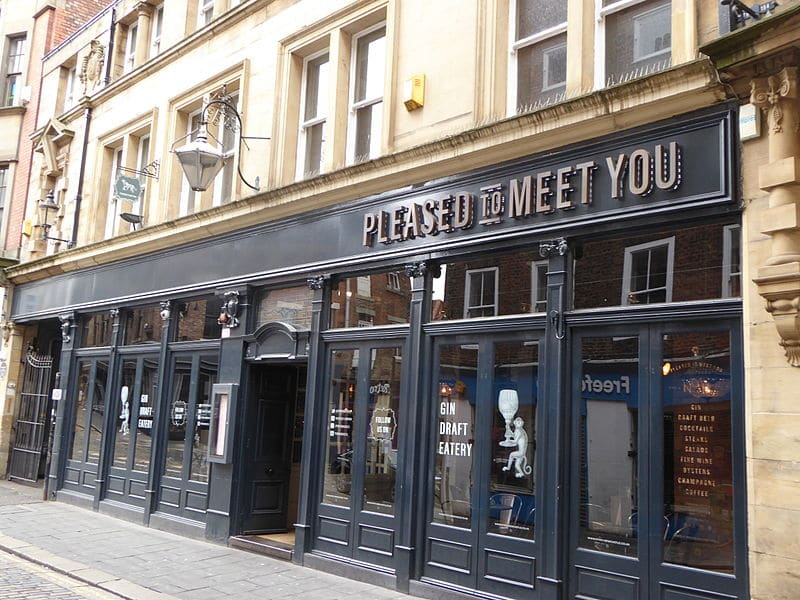 The exterior of two cocktail bars in Newcastle: Pleased to Meet You, with The Viceroy downstairs